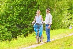 Two young Romantic Lovers Spending Their Time in Summer Forest O Royalty Free Stock Images