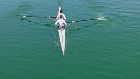 Two young rowers in a racing rower boat. Full HD video stock footage