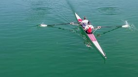 Two young rowers in a racing rower boat. Full HD video stock video footage