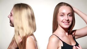 Two young sensual girl in studio stock video footage