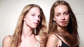 Two young sensual girl in studio stock footage