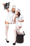 Two young sexual female doctors Royalty Free Stock Photos