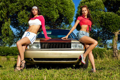 Two young sexy girl ready for car washing Stock Image