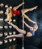 Two young sexy pole dance women Stock Photography