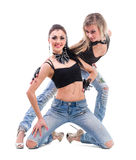 Two young sexy women in denim jeans isolated on Royalty Free Stock Photo