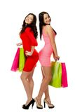 Two young shopping merry women Stock Images
