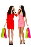 Two young shopping women talking by phone Stock Photo