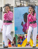 Two young singer on stage singing a song Stock Photo
