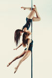 Pole dance team Stock Photos