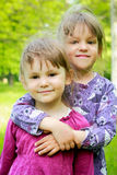 Two young smiling girls in the grass Stock Photo