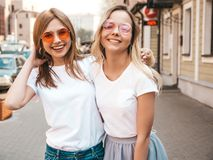 Two Young Smiling Hipster Blond Women In Summer White T-shirt Clothes Stock Photos