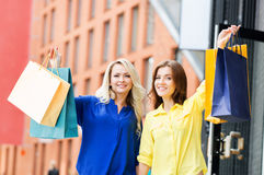 Two young and smiling women being happy Royalty Free Stock Image