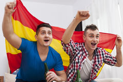 Two young spanish football fans Royalty Free Stock Photo