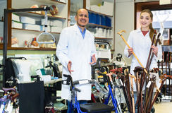 Two young specialists posing in orthopaedic shop. Two young specialists in white uniform posing in orthopaedic shop stock images