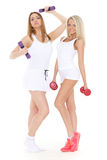 Young sports women with dumbbells. Royalty Free Stock Photos