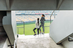 Two young sportswomen standing at handrail on stadium Royalty Free Stock Photo