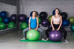 Two young sporty woman in the gym stock photography