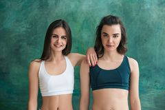 Two young sporty women posing at gym. Stock Photography