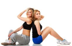 Two young sporty women after workout Royalty Free Stock Photos