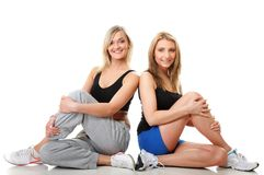 Two young sporty women after workout Stock Photos