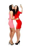 Two young  stand embracing women send kiss Royalty Free Stock Photo