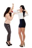 Two young standing women crying in megaphone Royalty Free Stock Photo