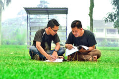 Two young student reading books. In front of class Stock Photography