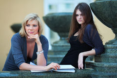 Two young students on campus. Stock Image