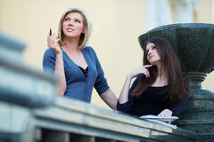 Two young students on campus. Royalty Free Stock Photography