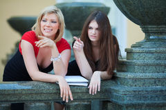Two young fashion female students on campus Stock Images