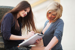 Two young students on campus Stock Images