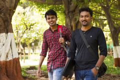 Two young students going to college stock image