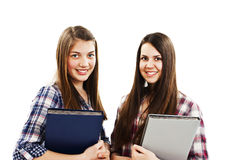Two young students holding a book and smiling Stock Image