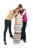 The two young students isolated on a white Royalty Free Stock Photo