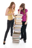 The two young students isolated on a white Royalty Free Stock Photos