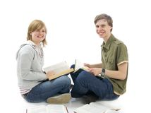 The two young students isolated on a white stock photo
