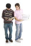 The two young students isolated on a white Royalty Free Stock Images