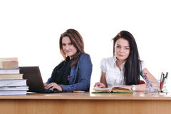 Two young students are learning at the table Stock Images