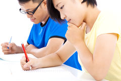 Two young students learning together in classroom Stock Photography