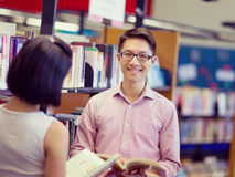 Two young students at the library. Two young students working together at the library royalty free stock photos