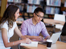 Two young students at the library Royalty Free Stock Image