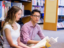 Two young students at the library Stock Photography