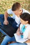 Two young students outdoors Royalty Free Stock Photography