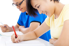 Two young students studying together in classroom Royalty Free Stock Images