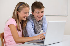 Two young students working on a laptop Stock Images
