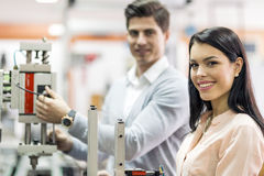 Two young students working on a project together in lab Royalty Free Stock Photo