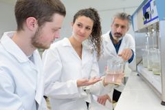 Two young students working on science project in lab Stock Images