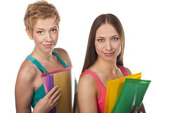 Two young studenys woman on the white background Stock Photography