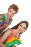 Two young studenys woman on the white background Royalty Free Stock Photos
