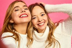 Two young stylish woman models in summer hipster clothes royalty free stock photo